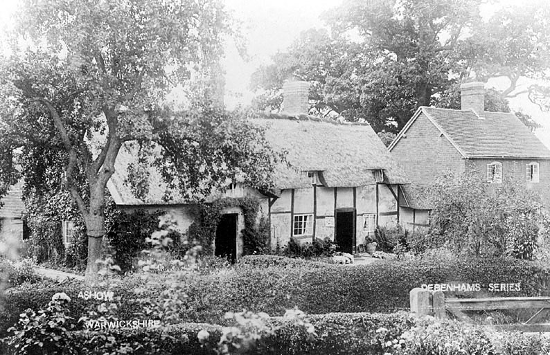 Timber framed , thatched cottages with outbuilding , surrounded by garden and trees with brick house next door.  1900s |  IMAGE LOCATION: (Warwickshire County Record Office)