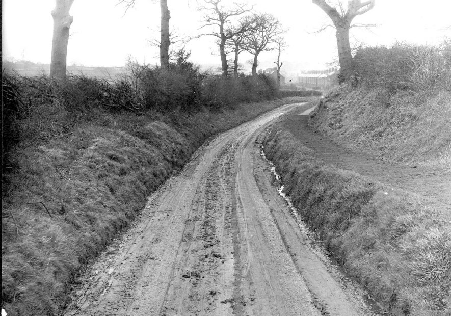 Lane with road works notice and a distant view of Stockingford, Galley Common, Nuneaton.  1930s |  IMAGE LOCATION: (Nuneaton Library)