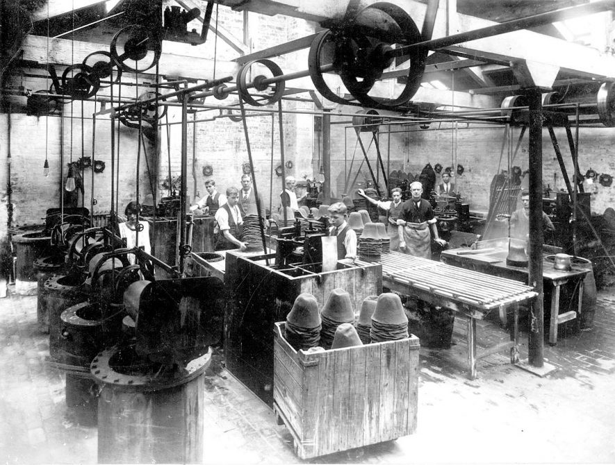 Hall & Phillips, hatters, Nuneaton.  Interior of workshop in factory, men & machinery.  1920s |  IMAGE LOCATION: (Nuneaton Library)