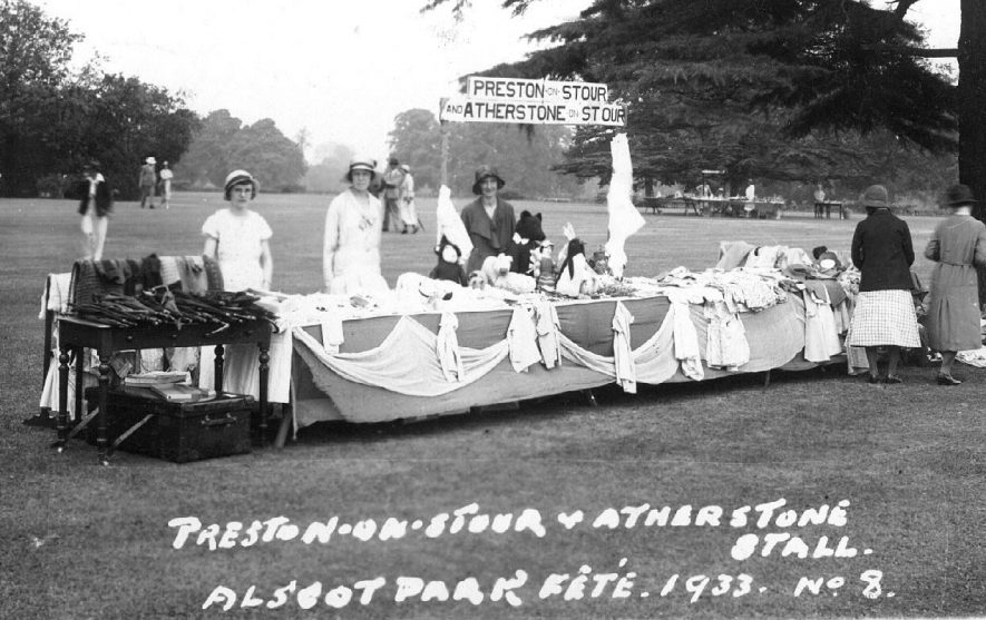 A stall at Alscot Park Fete. Preston on Stour and Atherstone Stall showing clothes and toys for sale and ladies behind counter.  1933 |  IMAGE LOCATION: (Warwickshire County Record Office)