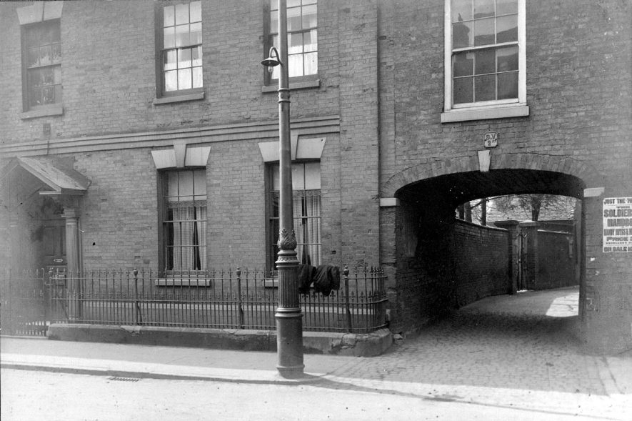 Pettifer's Archway, Nuneaton. Mrs Pettifer's house stood a little way up a wide passage which opened into the street through an archway.  1900s |  IMAGE LOCATION: (Nuneaton Library)