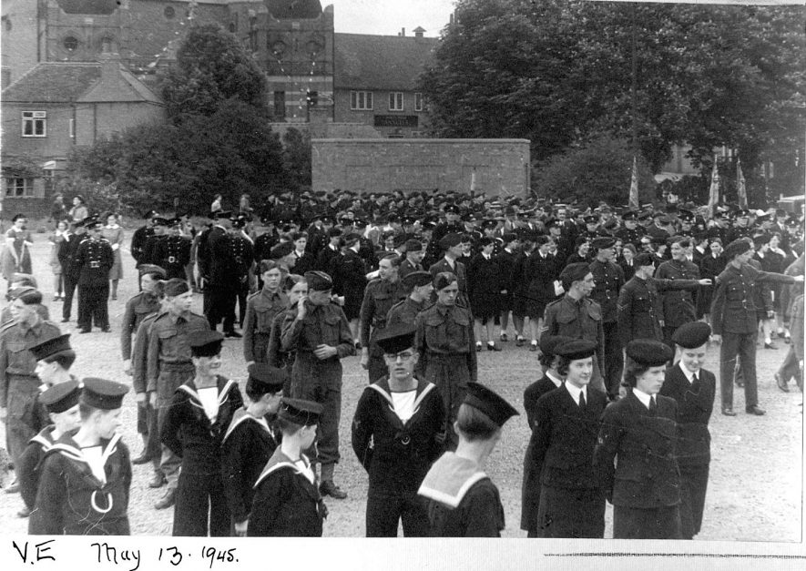 Crowd of uniformed people assembling for V.E. parade in Nuneaton.  May 13th 1945 |  IMAGE LOCATION: (Nuneaton Library)