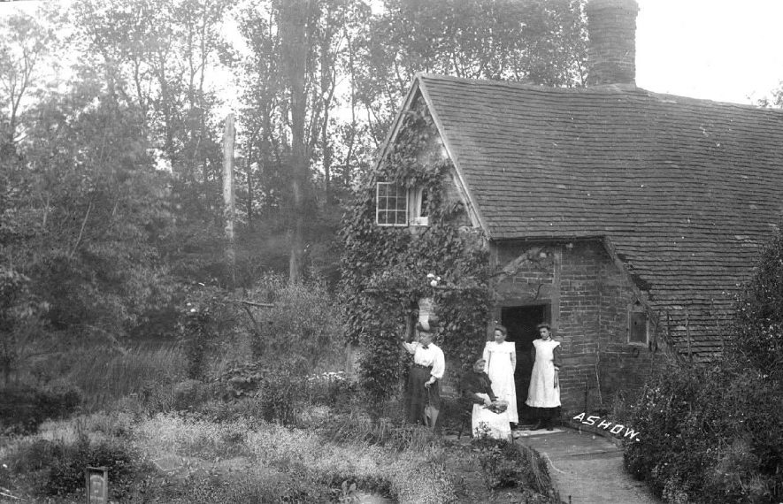 Four ladies, in the doorway of Avon Cottage. The lady sitting is Mrs S. Harris.  1900s |  IMAGE LOCATION: (Warwickshire County Record Office)