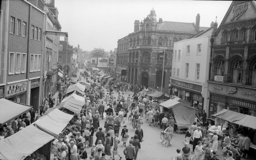 Nuneaton, Market Place on market day, as viewed from the billiards hall above Burton's.  June 13th 1959 |  IMAGE LOCATION: (Warwickshire County Record Office)