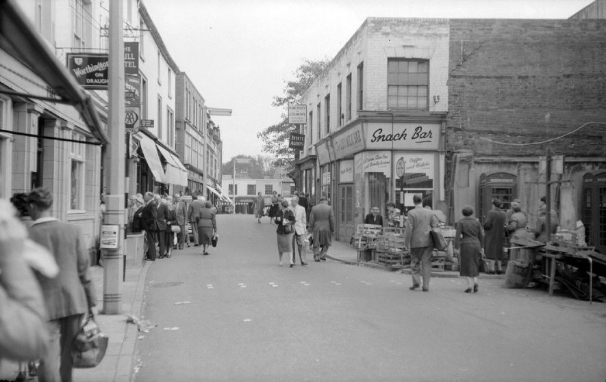 Nuneaton Market Place, looking towards Bridge Street.   Shops and pedestrians.  September 26th 1959 |  IMAGE LOCATION: (Warwickshire County Record Office)