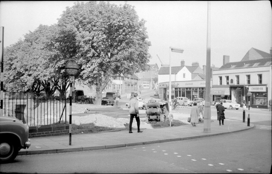 Bond Gate, Nuneaton, showing cleared site for new shops. On the opposite side of the road is a car show room and other shops.  September 28th 1959