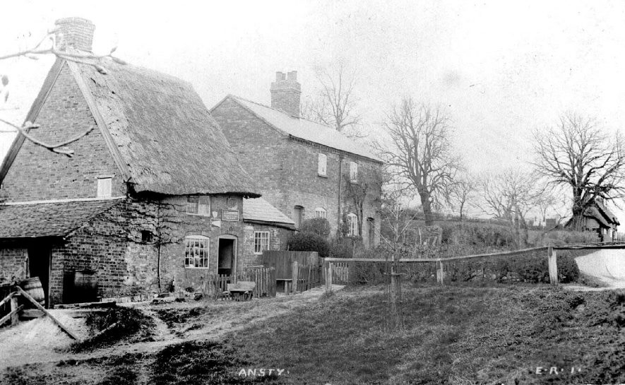 Group of rural cottages with gardens in Ansty.  1900s |  IMAGE LOCATION: (Warwickshire County Record Office) SCAN DATE: (1/1197)
