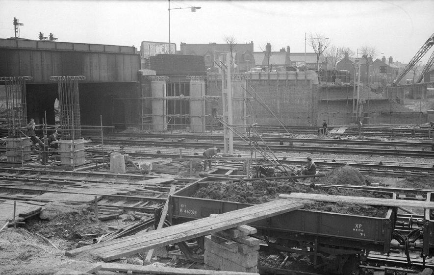 Work on the new road  bridge, at the side of the old bridge, which is being demolished, in Leicester Road, over the main London to Glasgow railway line.  1962 |  IMAGE LOCATION: (Warwickshire County Record Office)