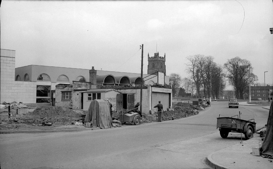 Abbey service station in Church Street, in the course of demolition.   This was in front of the newly constructed Public Library.  1900s |  IMAGE LOCATION: (Warwickshire County Record Office)