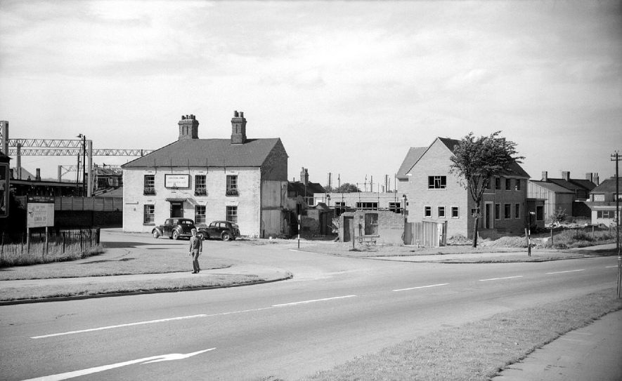 The old Graziers Arms public house on the left, and the new Graziers Arms on the right, in the Weddington Road.  1962 |  IMAGE LOCATION: (Warwickshire County Record Office)