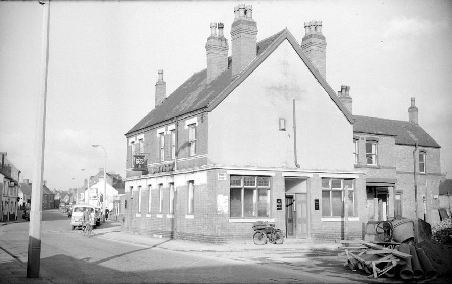 The Wheatsheaf Inn in Abbey Street.  This picture is taken looking towards Abbey Green.  The landlord at the time was Harry Hopkins.  1962 |  IMAGE LOCATION: (Warwickshire County Record Office)