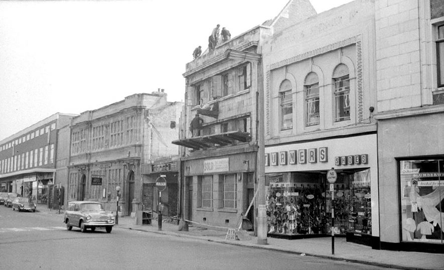 Demolition work on Lesters (Chemist) shop in the Market Place.  1964 |  IMAGE LOCATION: (Warwickshire County Record Office)