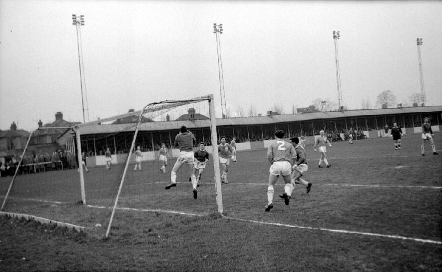 Rugby v Nuneaton Borough Football Club, Southern League, premier division match at Rugby. Score Rugby 3 Nuneaton 1.Goalkeeper Crosby gathering the ball.  February 15th 1964 |  IMAGE LOCATION: (Warwickshire County Record Office)