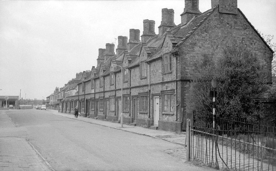 Terraced houses in Wheat Street, Nuneaton, just prior to their demolition.  April 26th 1964 |  IMAGE LOCATION: (Warwickshire County Record Office)