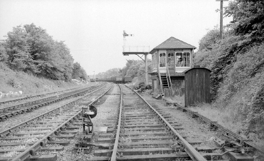 Rugby Wharf signal box and signal on the closed Rugby to Leicester railway line.  May 23rd 1964    IMAGE LOCATION: (Warwickshire County Record Office)