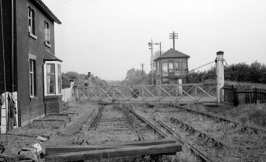 Willey level crossing, looking towards Rugby, with the A5 Watling Street crossing through the centre of the picture. Picture taken just before the railway line was dismantled.  May 27th 1964 |  IMAGE LOCATION: (Warwickshire County Record Office)