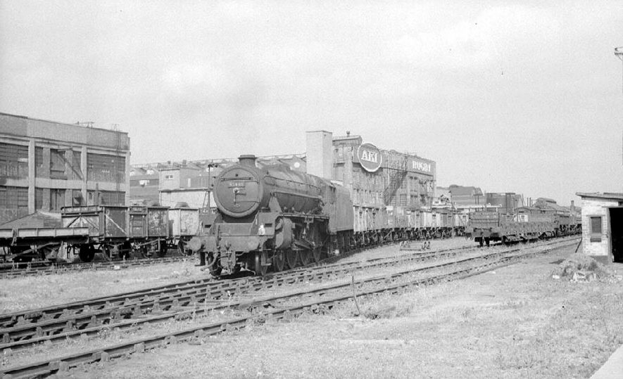 Steam train, engine no. 45448 heads a freight train out of the sidings at Rugby Midland Station.  July 6th 1964 |  IMAGE LOCATION: (Warwickshire County Record Office)