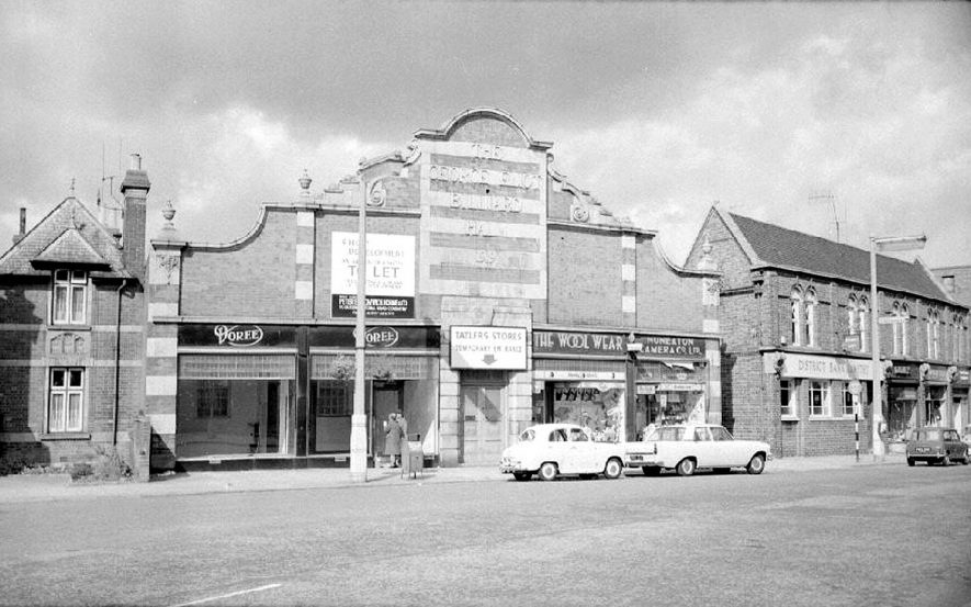 The George Eliot buildings in Coton Road, Nuneaton. The Nuneaton Camera Co. shop closed at the end of September 1964 just after this picture was taken. |  IMAGE LOCATION: (Warwickshire County Record Office)