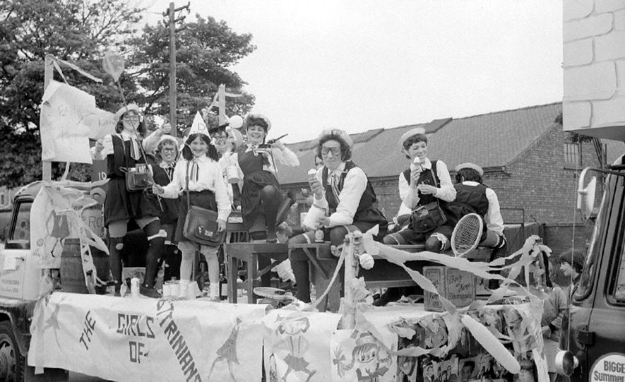 The Girl's of St Trinian's in the Nuneaton Carnival procession in Caldwell Road.  June 5th 1965 |  IMAGE LOCATION: (Warwickshire County Record Office)
