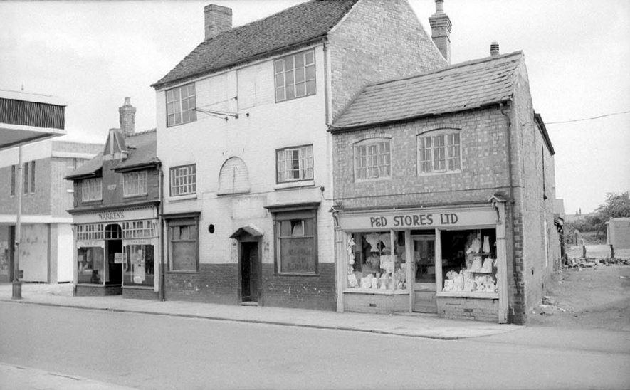 Property in Queens Road, Nuneaton just prior to its demolition. In the centre left is Jack Warren's sweet shop and next to it The George and Dragon pub, also closed.  July 4th 1965 |  IMAGE LOCATION: (Warwickshire County Record Office)