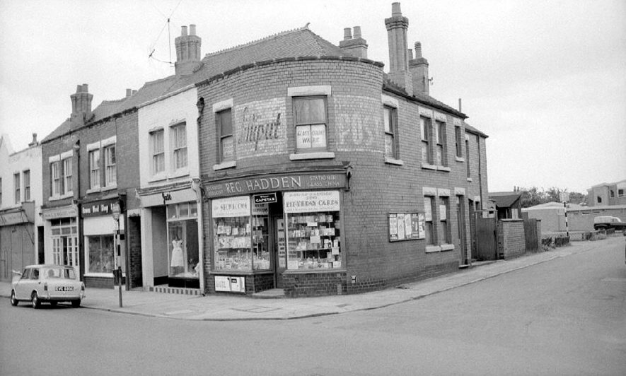 Reg Hadden's newsagents and book shop at corner of Queen's Road and Dugdale Street, Nuneaton.  July 4th 1965 |  IMAGE LOCATION: (Warwickshire County Record Office)