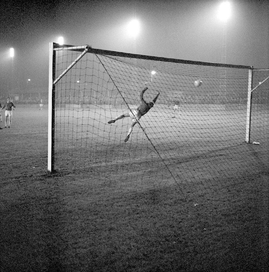 First goal of match between Nuneaton & Leicester City played under new floodlights at Manor Park, Nuneaton.  Leicester goalkeeper, Peter Shilton, fails to save a goal scored by Nuneaton centre-forward Bill Atkinson.  October 25th 1965 |  IMAGE LOCATION: (Warwickshire County Record Office) PEOPLE IN PHOTO: Atkinson, Bill