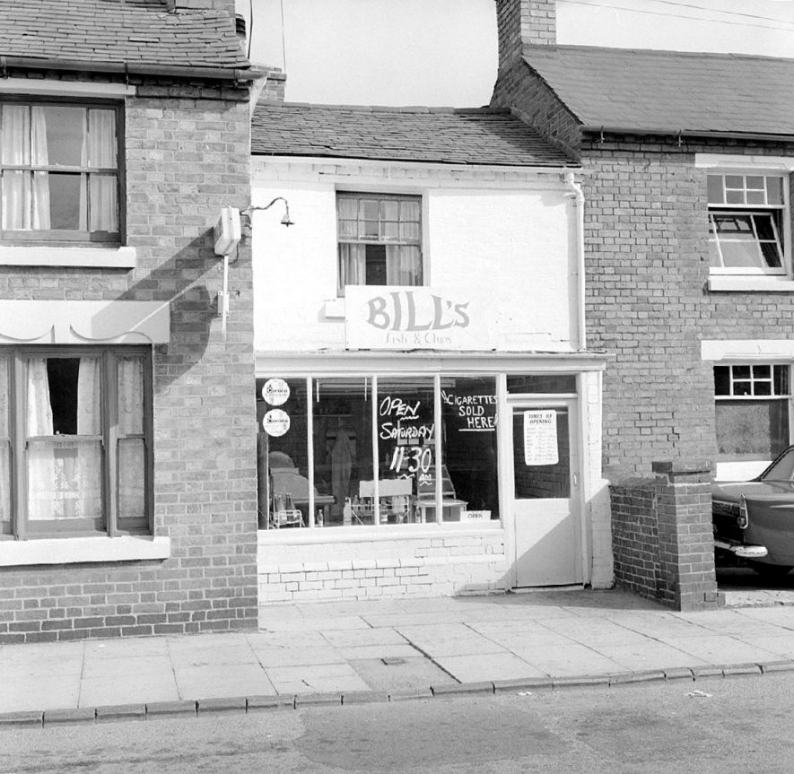 Bill's fish & chip shop in Bridge Street, next to Coton Conservative Club (at right of picture), Chilvers Coton.  September 10th 1966    IMAGE LOCATION: (Warwickshire County Record Office)