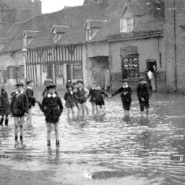 Coleshill.  High Street, flooding