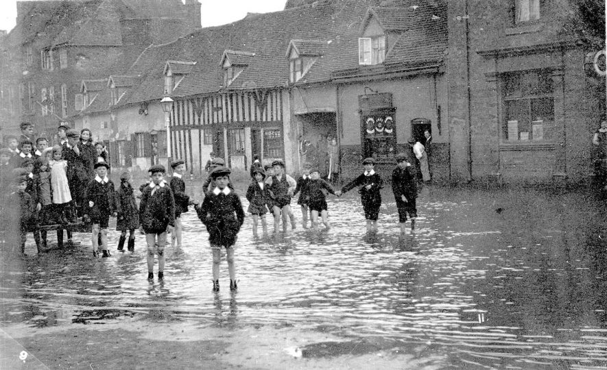 Children paddling in flood waters in High Street, Coleshill.  1912 |  IMAGE LOCATION: (Warwickshire County Record Office)
