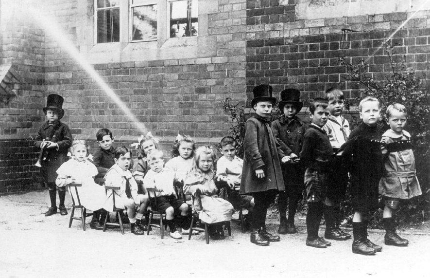 Children arranged to form
