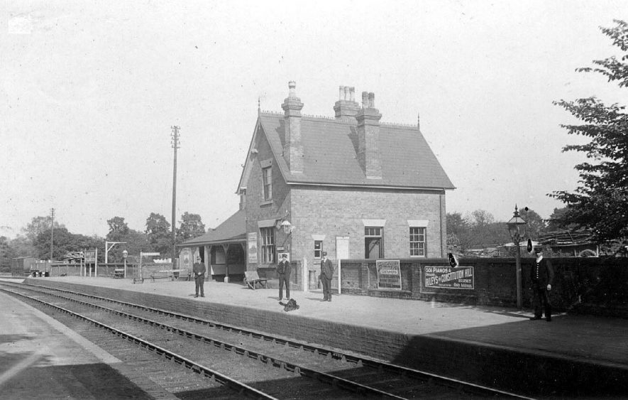 Four station personnel on the platform at Arley and Fillongley station.  1907 |  IMAGE LOCATION: (Warwickshire County Record Office)
