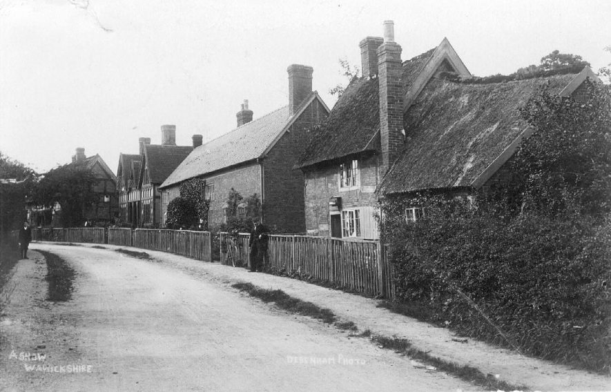 Ashow street showing timber framed house, thatched house and brick house with wooden fencing outside.  1906 |  IMAGE LOCATION: (Warwickshire County Record Office)