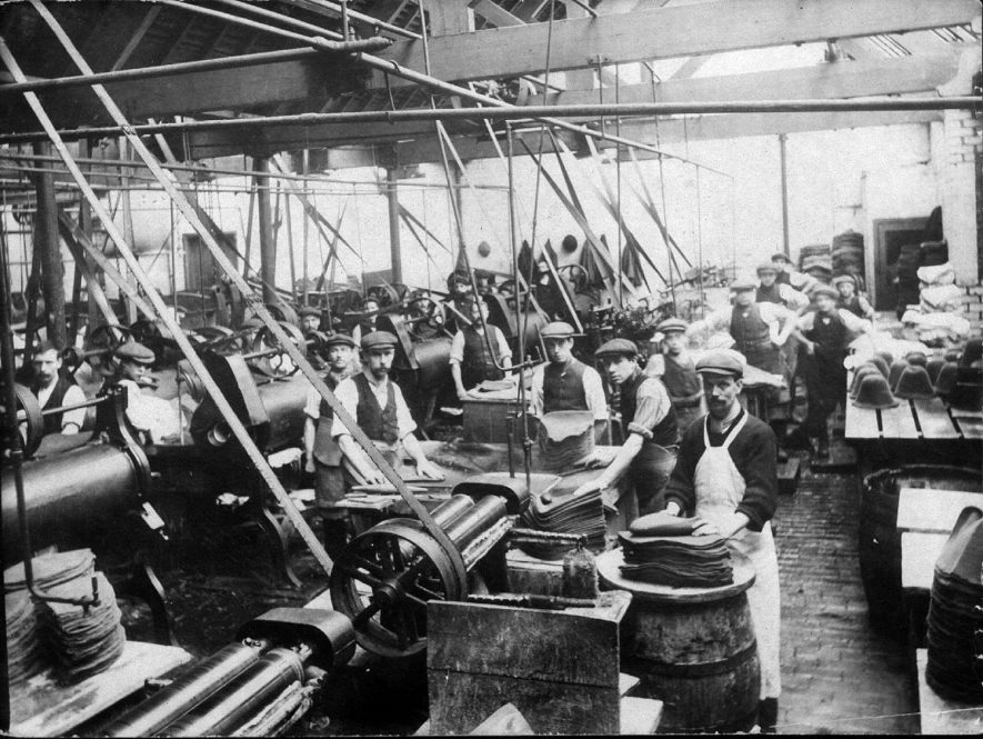 Workers at their machines at Luckman & Pickering's hat making factory in Bedworth.  1900s |  IMAGE LOCATION: (Warwickshire County Record Office)