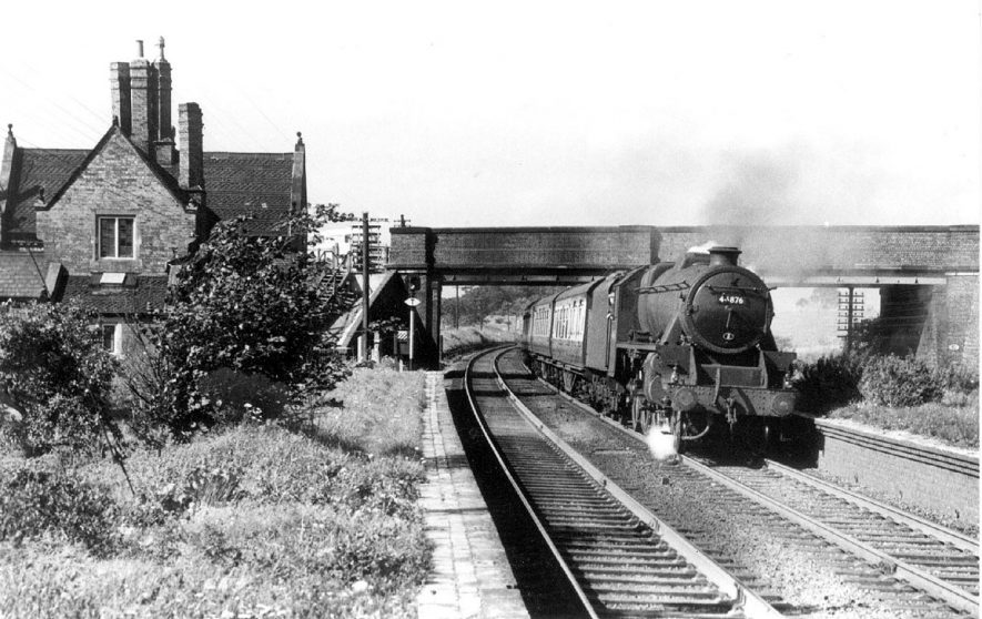 Steam train passing through Bulkington station.  1957 |  IMAGE LOCATION: (Warwickshire County Record Office)