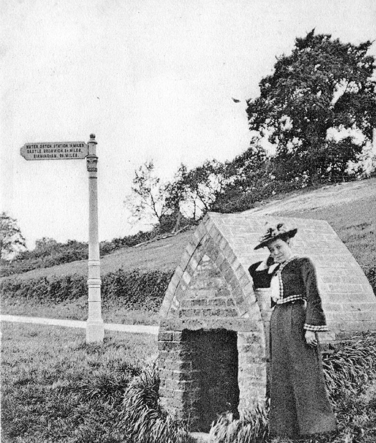 The Beggars Well, Coleshill. with a lady leaning on the well.  1900s |  IMAGE LOCATION: (Warwickshire County Record Office)