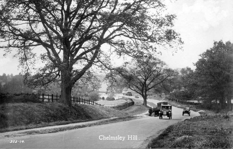 The old Chester Road, between Castle Bromwich and Stonebridge.  In the distance is Bacon's End Bridge.   The lorry belonged to JB & S Lees Ltd a firm of iron founders and timber merchants in West Bromwich.   The lorry on the bridge is hauled by a steam engine.  1920s |  IMAGE LOCATION: (Warwickshire County Record Office)