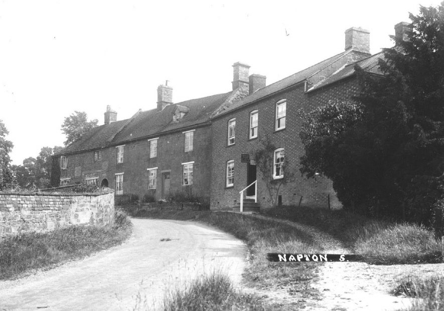 A street in the village,  Napton on the Hill.  1930s   [View looking up Hillside. The with the white hand rail is is the village Cobblers.] |  IMAGE LOCATION: (Warwickshire County Record Office)