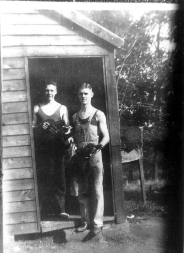George Hill and his brother making pit boots at Arley.  1930s |  IMAGE LOCATION: (Warwickshire Museums. Photographic Collections.) PEOPLE IN PHOTO: Hill, George