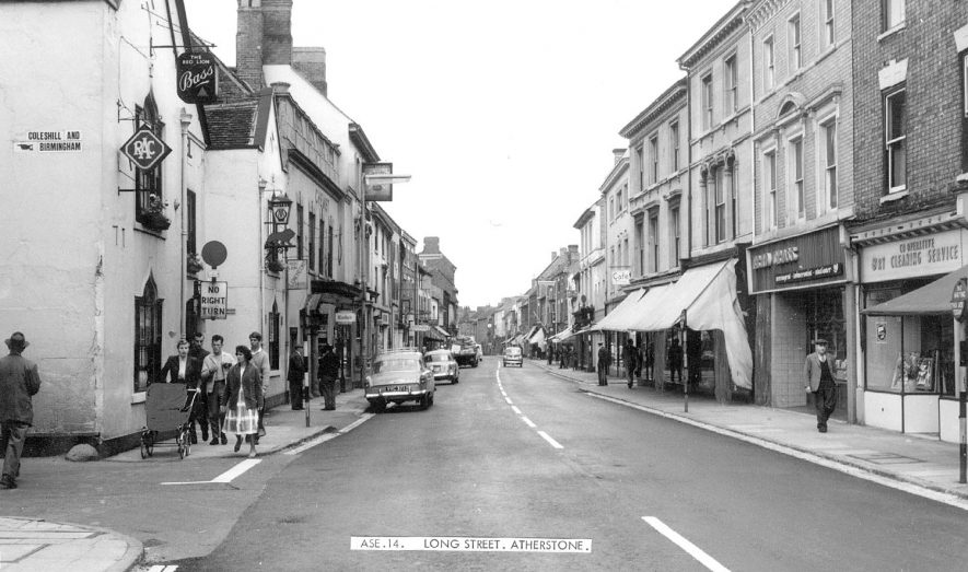 Long Street, Atherstone showing shops and cars.  1960s |  IMAGE LOCATION: (Warwickshire County Record Office)