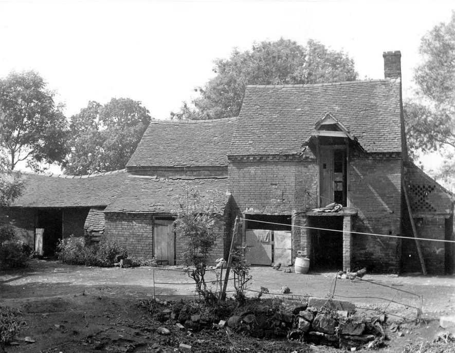 View of the outbuildings at Alders Mill, showing the overall dilapidated condition of the roofs and brickwork.  1950s |  IMAGE LOCATION: (Warwickshire Museums. Photographic Collections.)