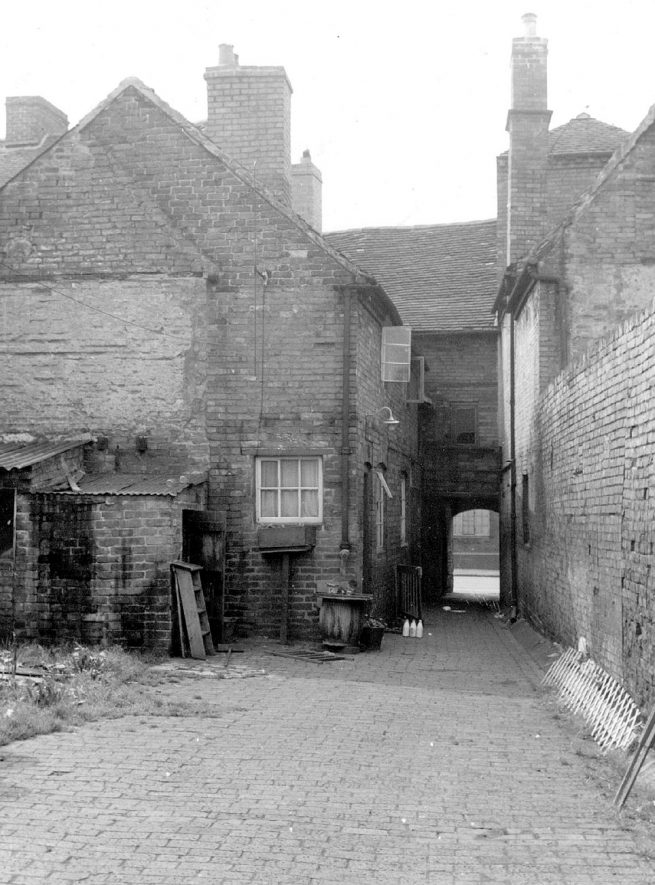 View of the gable and front entrances to nos. 1 and 2, Rumsey's Yard, Long Street.  1950s |  IMAGE LOCATION: (Warwickshire Museums. Photographic Collections.)
