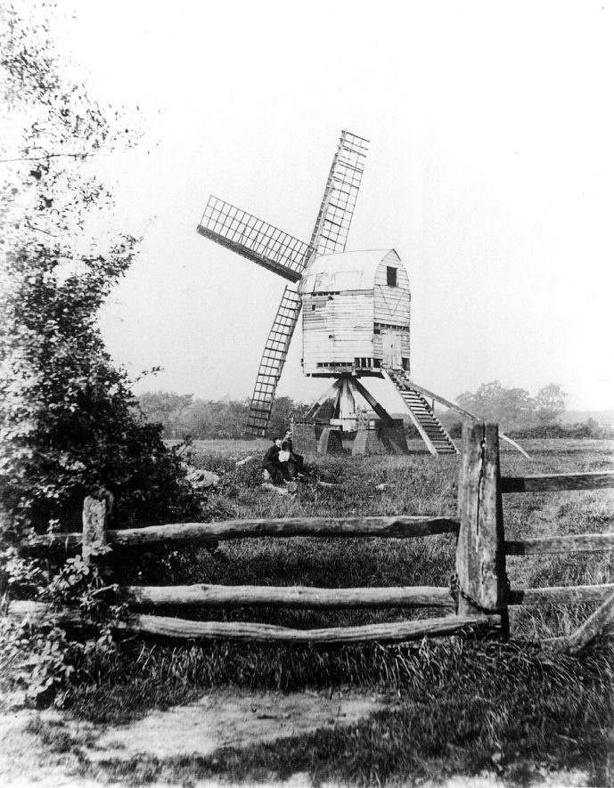 Baxterley Windmill in the 1900s.Built 'J.B.' in 1793 on Baxterley Common. Ceased by late 1880s. Demolished c.1969. Main post used for reconstruction of the Danzey Green Mill, [Tanworth] at Avoncroft Museum of Buildings.Post Mill, open trestle, 4 common sails, ladder and tailpole. |  IMAGE LOCATION: (Warwickshire Museums. Photographic Collections.)