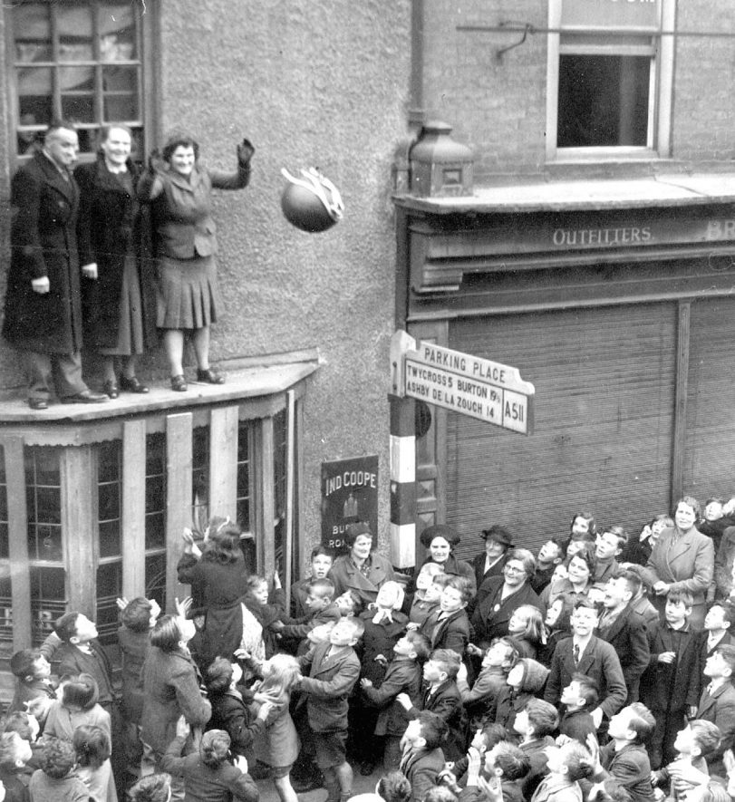 Atherstone Annual Shrove Tuesday street ball game.  The throw in from the Bluebell Inn.  1930s |  IMAGE LOCATION: (Warwickshire Museums. Photographic Collections.)