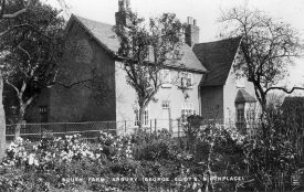 South Farm, Arbury Estate, Arbury. Birthplace of George Eliot (Mary Ann Evans). Farmer standing outside.  1900s |  IMAGE LOCATION: (Warwickshire County Record Office)