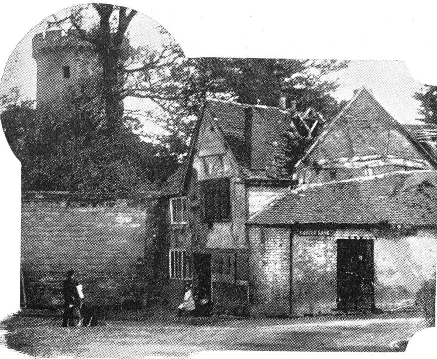 Cottages under the castle wall at the turn of the 20th century.  1905 |  IMAGE LOCATION: (Warwickshire County Record Office)