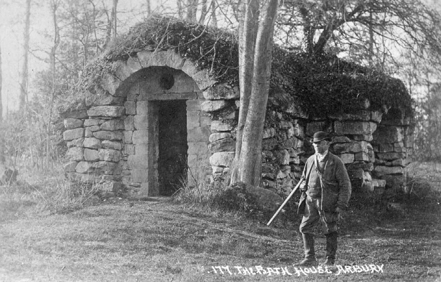 A man with a shotgun outside The Bath House, Arbury Hall.  1905 |  IMAGE LOCATION: (Warwickshire County Record Office)