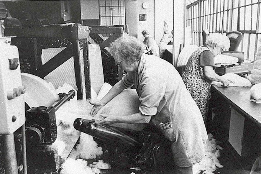 The Mill hatmaking workshop, Atherstone.  Pure sheep's wool is made into flat sheets and then into rough cone shapes.  1950s [ Identified as the Forming Shop.]  |  IMAGE LOCATION: (Warwickshire Museums. Photographic Collections.)