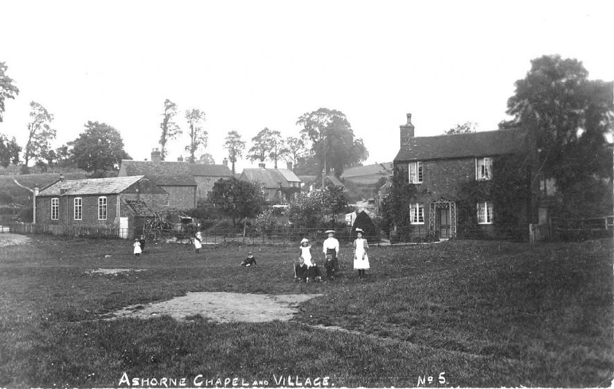 Ashorne Chapel and village with children on the green.  1908 |  IMAGE LOCATION: (Warwickshire County Record Office)