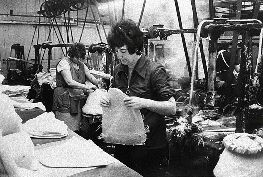 Hatmaking in Atherstone. Hardening shop - the beginning of the felting process when the cones are steam heated and buffed.  1950s |  IMAGE LOCATION: (Warwickshire Museums. Photographic Collections.)