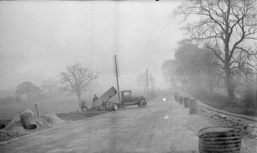 Road maintenance with lorry and workmen, Curdworth.  1930s |  IMAGE LOCATION: (Warwickshire Museums. Photographic Collections.)